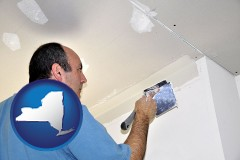 new-york a contractor spackling drywall