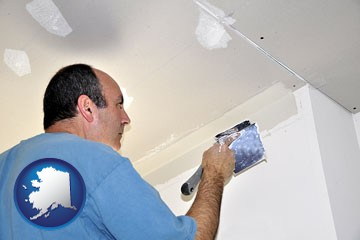 a contractor spackling drywall - with Alaska icon