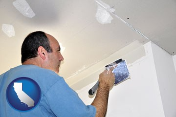 a contractor spackling drywall - with California icon