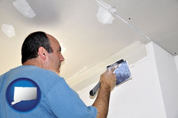 a contractor spackling drywall - with Connecticut icon