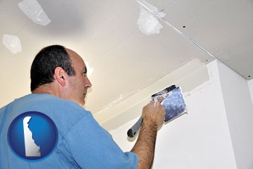 a contractor spackling drywall - with Delaware icon