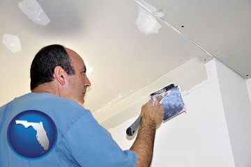 a contractor spackling drywall - with Florida icon