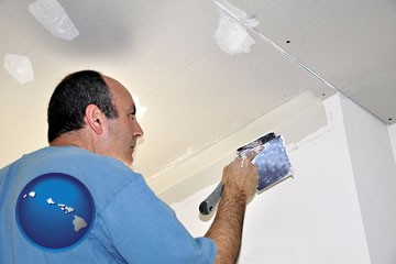 a contractor spackling drywall - with Hawaii icon