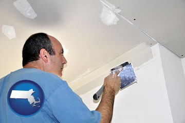 a contractor spackling drywall - with Massachusetts icon