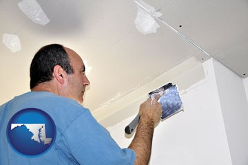a contractor spackling drywall - with Maryland icon
