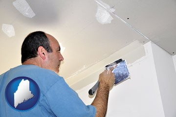 a contractor spackling drywall - with Maine icon