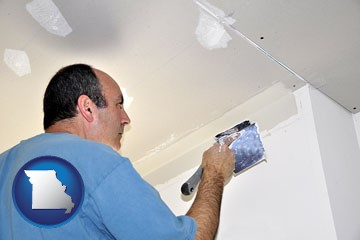 a contractor spackling drywall - with Missouri icon