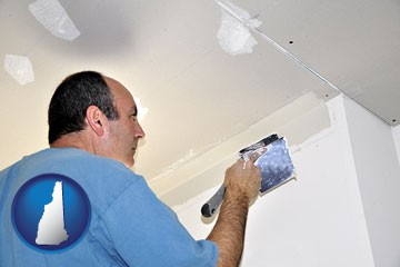 a contractor spackling drywall - with New Hampshire icon