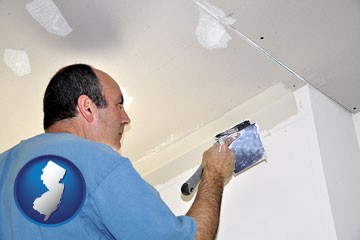 a contractor spackling drywall - with New Jersey icon