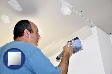 a contractor spackling drywall - with New Mexico icon