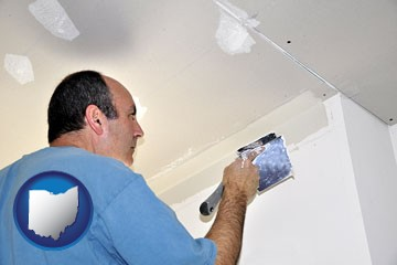a contractor spackling drywall - with Ohio icon