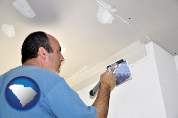 a contractor spackling drywall - with South Carolina icon