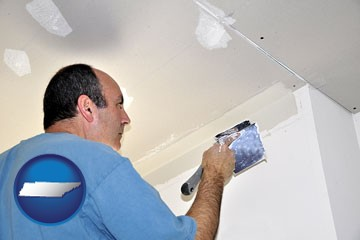 a contractor spackling drywall - with Tennessee icon