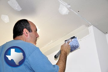 a contractor spackling drywall - with Texas icon