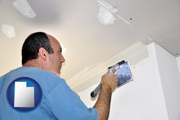 a contractor spackling drywall - with Utah icon
