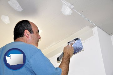 a contractor spackling drywall - with Washington icon