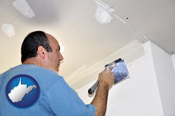 a contractor spackling drywall - with West Virginia icon